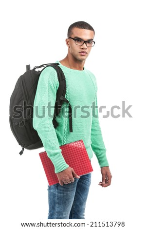 Young pensive student carrying bag. picture of travelling student with backpack and book - stock photo