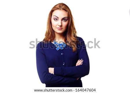Young pensive woman with arms folded isolated on a white background - stock photo
