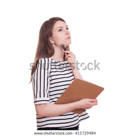 Young pensive woman with clipboard standing isolated on a white background. Stock image.