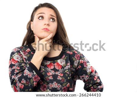 Young pensive woman with the hand on her chin  - stock photo