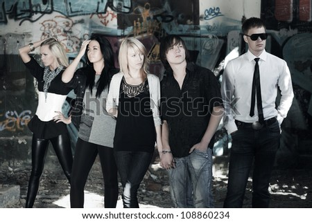 Young people against a graffiti - stock photo