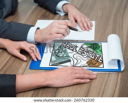 young people analyze real estate, close up - stock photo