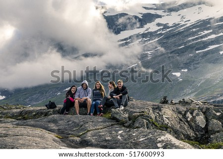 Young people are having fun on the top of mountain, Trollstigen,