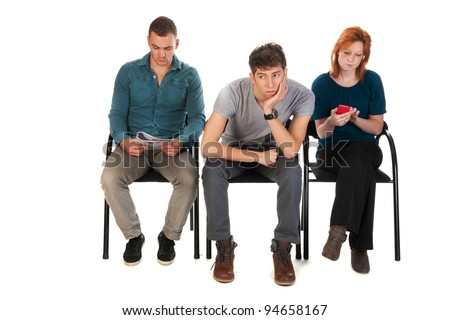 Young people are waiting in a room - stock photo