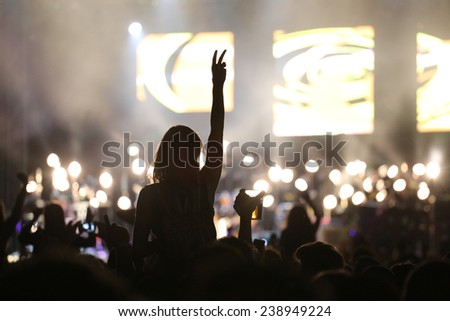 Young people at concert  - stock photo