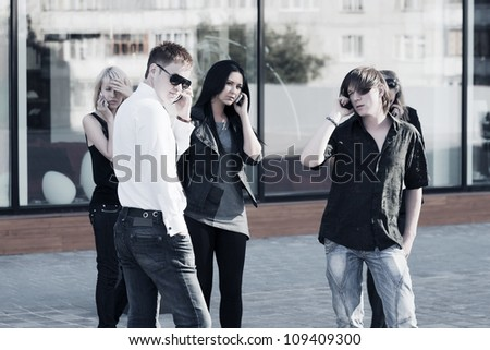 Young people calling on the phones - stock photo