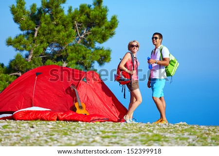 young people camping in mountains - stock photo