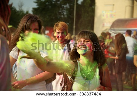Young people celebrate Holi color festival in park - stock photo