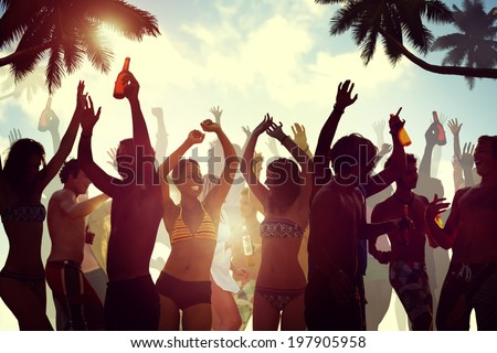 Young People Celebrating by the Beach - stock photo