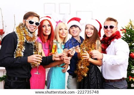Young people celebrating Christmas  - stock photo