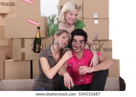 Young people celebrating on moving day
