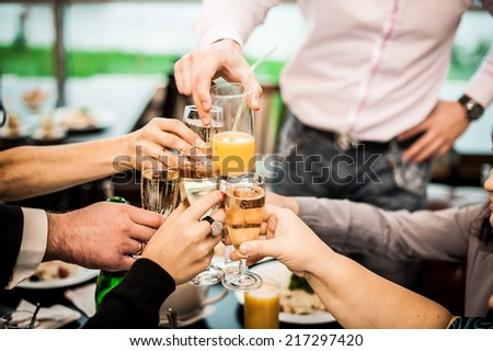 Young people congratulate each other on a holiday or an event. - stock photo