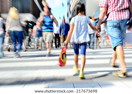 Young people crossing street - stock photo