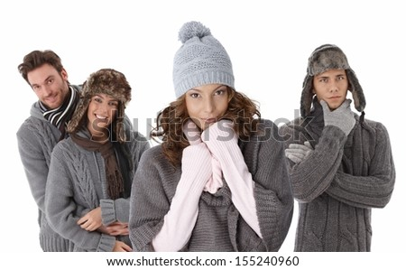 Young people dressed for winter fun, wearing hat, gloves and warm sweater.