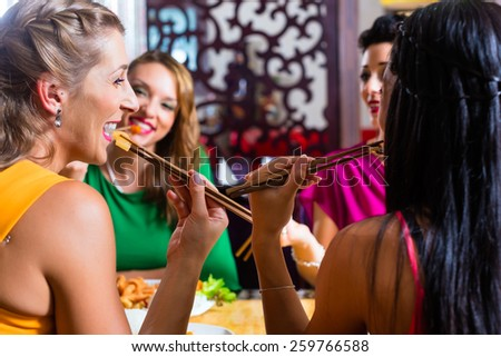 Young people eating in Asia restaurant - stock photo
