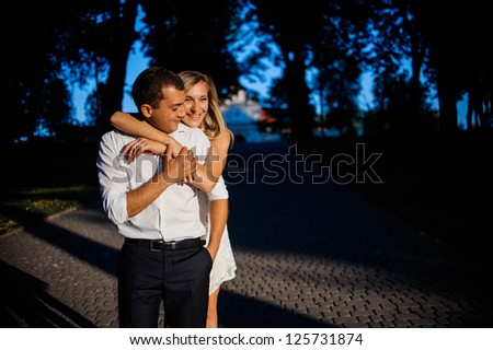 Young people embracing on a calm summer day - stock photo