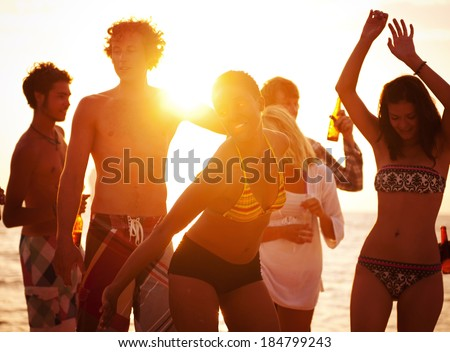 Young people enjoying a summer beach party.