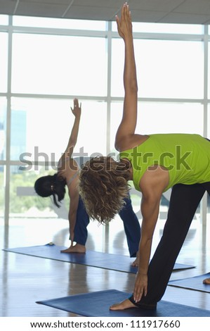 Young people exercising in aerobics class - stock photo