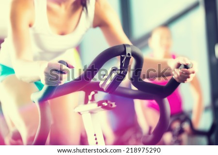 Young People - group of women and men - doing sport in the gym for fitness - stock photo