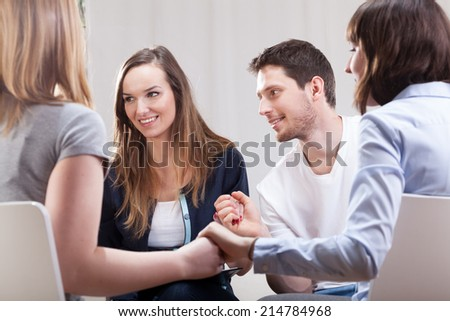 Young people happy and satisfied on group therapy for addicted - stock photo