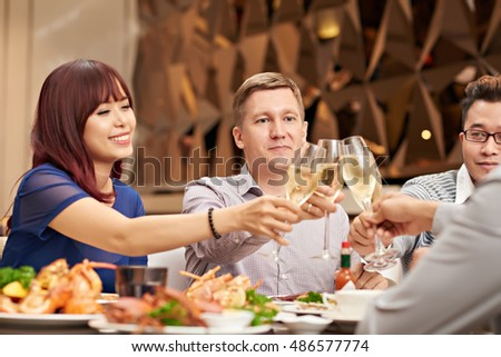 Young people having birthday dinner in restaurant