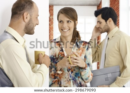 Young people having coffee-break, talking, smiling happy. - stock photo