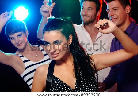 Young people having fun in discotheque, nightclub, dancing, drinking.? - stock photo