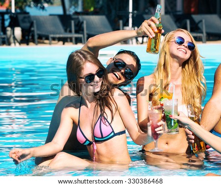 Young people having fun in the swimming pool