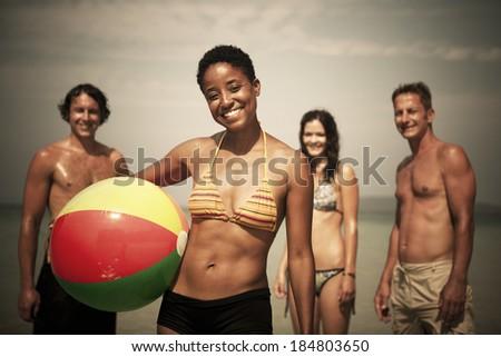 Young People Having Fun On The Beach - stock photo