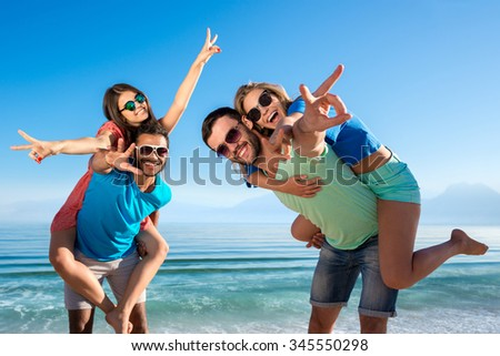 Young people having fun on the beach. Merry company resting on the sea. Travel around the world. Activities on the islands. Holiday at sea. Happy people. - stock photo