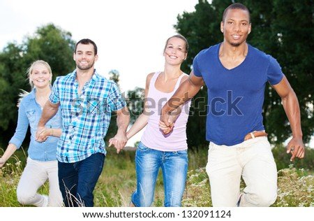 Young people having fun outside. - stock photo