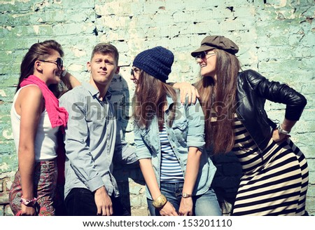 Young people having fun together outdoors, lifestyle, toned - stock photo