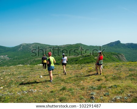 Young people hikes in Crimea mountains