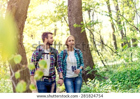 Young people hiking - stock photo