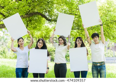 young people holding a big white board