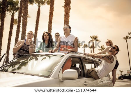 Young People in a car having fun on a Road trip