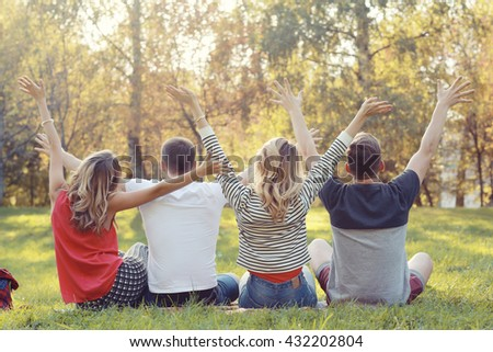 young people in autumn park in Europe - stock photo