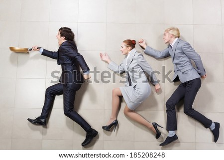 Young people in business suits lying on floor - stock photo