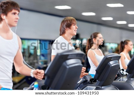 Young people in fitness club - stock photo