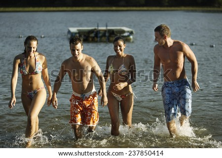 Young People in Lake - stock photo