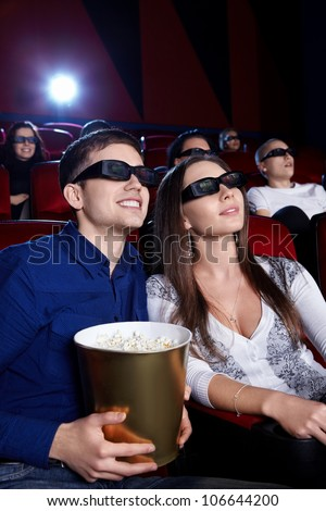 Young people in the 3D glasses at the cinema - stock photo