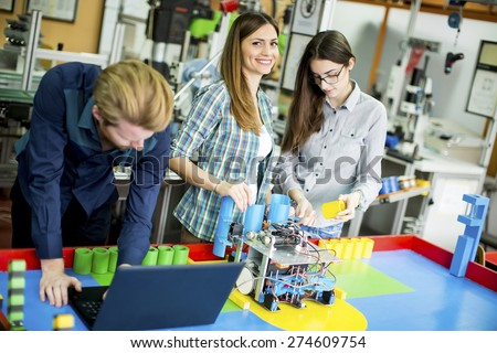 Young people in the robotics classroom - stock photo