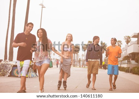Young People in their twenties on the Venice Beach boaardwalk in California - stock photo