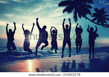 Young People Jumping with Excitement on the Beach - stock photo