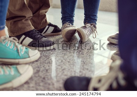 Young people legs standing in circle - stock photo