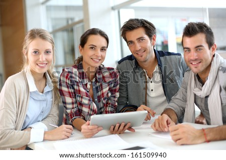 Young people meeting with digital tablet - stock photo