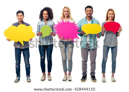 Young people of different nationalities with speech bubbles are looking at camera and smiling, isolated on white background - stock photo