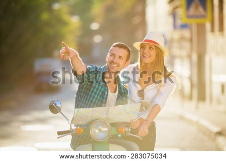 Young people on a scooter - stock photo