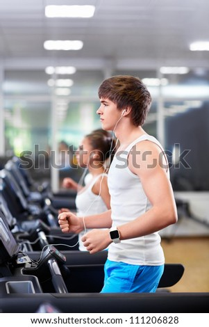 Young people on a treadmill - stock photo