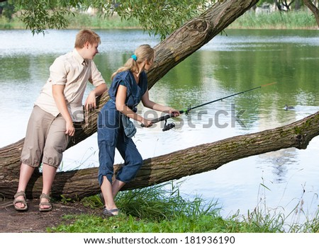 Young people on fishing - stock photo
